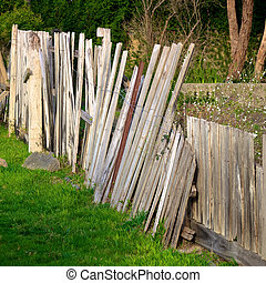broken fence - broken wooden fence in desperate need of...
