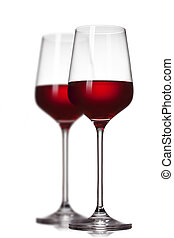 Two red wine glasses isolated on white