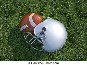 American football helmet and ball, on the grass. Close up....