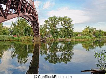 Arcuate footbridge over the River - Arcuate, a metal...