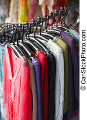 fashion sales, clothing on hangers at the show