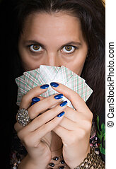 Gypsy woman with fan of cards and mysterious look