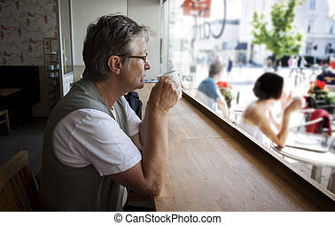 Old woman in cafe