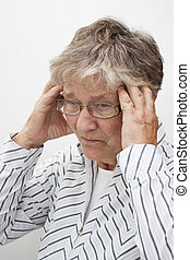 Old woman with head ache
