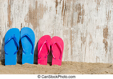 slippers on the beach - wheathered wood on the beach and...