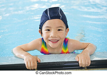 Little Swimmers - A young asian girl in the swimming pool