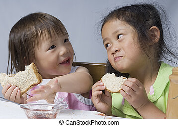 Peanut Butter Sandwiches - Two sisters making a mess with...