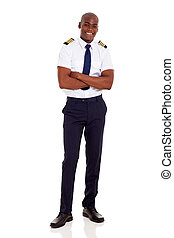 african airline captain with arms crossed - handsome african...