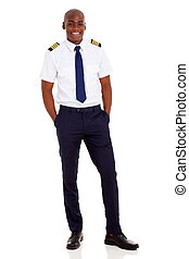 african airline pilot standing over white background -...