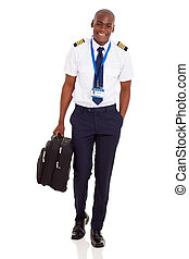 young airline pilot carrying briefcase - happy young airline...