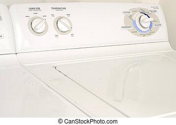 washing machine or washer and dryer - white washing machine...