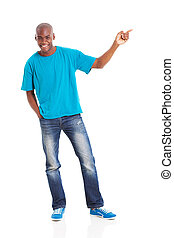 african man pointing at empty copy space - smiling african...