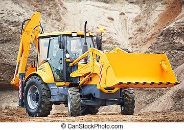loader excavator with risen shovel - Wheel excavator loader...