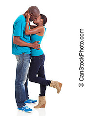young afro american couple kissing - intimate young afro...
