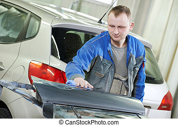 automobile car body check - repairman worker in automotive...