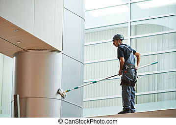 woman worker cleaning indoor window - woman cleaner worker...