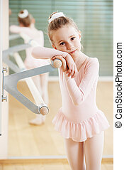 girl at ballet training - Little girl in ballet suit at...