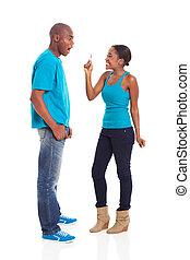 surprised man looking at girlfriend's pregnancy test
