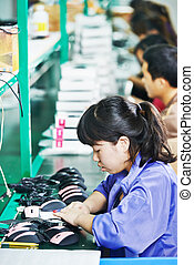 female chinese worker in factory - female chinese worker...