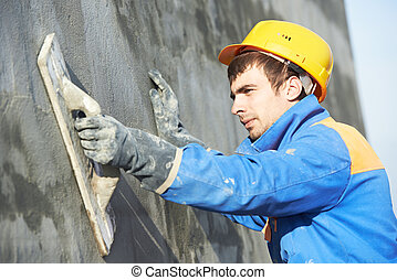 builder worker at plastering facade work - Young builder...
