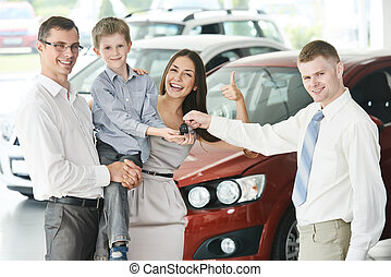 Family buying a car - At automobile sales centre Car...