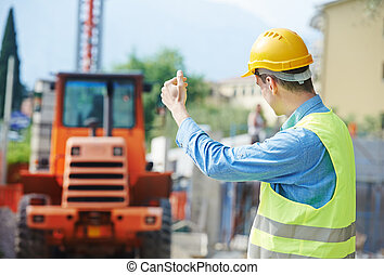 construction worker in safety protective work wear ruling...