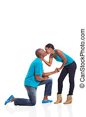 African American woman kissing her boyfriend after he...