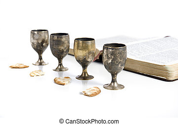 Communion - Four small cups with wine and bread. Communion