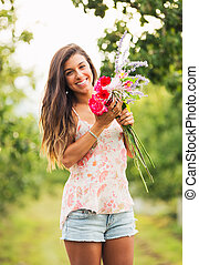 Young Woman with Flowers - Beautiful Young Woman with...