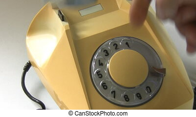 Emergency Dialing 119 - A hand lifts telephone receiver and...