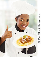 female african american chef giving thumb up - smiling...