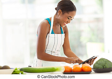 african woman searching for a recipe - pretty african woman...