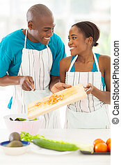 african couple preparing a salad - cute african couple...