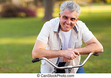 middle aged man on a bike