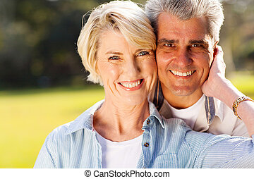 lovely mid age husband and wife portrait outdoors