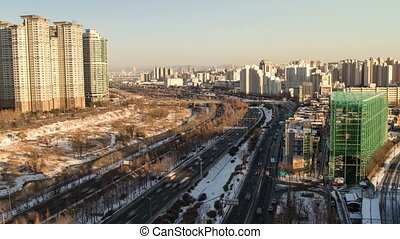 Seoul City Zoom 102 - 102) Zooming time lapse of traffic and...