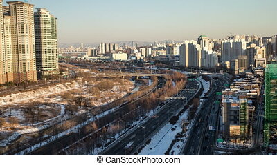 Seoul City 103 - 103) Time lapse of traffic and architecture...