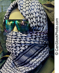 Incognito - mannequin head with black and white scarf and...