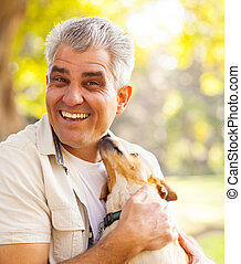 middle aged man and pet dog