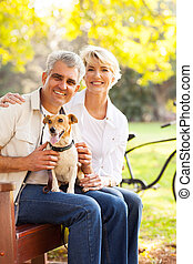 senior couple and pet dog - happy senior couple and pet dog...