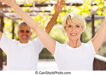 senior couple working out - healthy senior couple working...