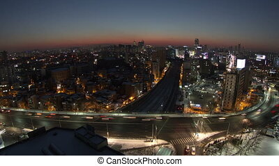 Seoul City Zoom 117 - 117) Zooming time lapse of traffic and...