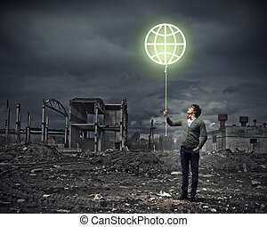 Young man and the symbol of our planet
