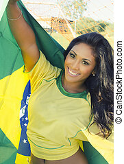 Happy Brazil football soccer fan - Attractive young woman...