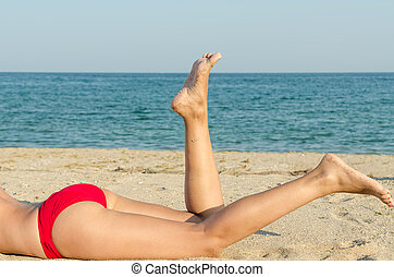 Feet Of Young Girl In Vacation