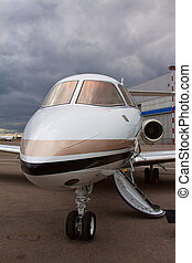 ladder in a private plane on the background of a cloudy sky