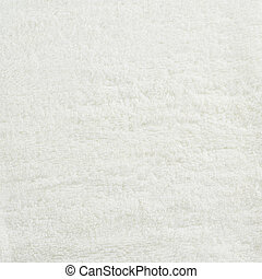 Shaggy white carpet fragment as a texture background