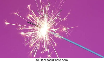 Sparklers over pink background