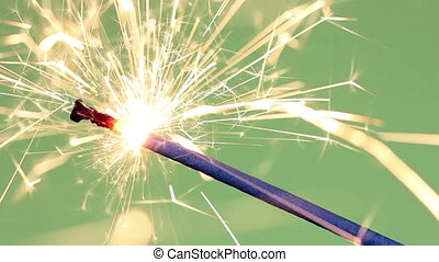 Sparklers over green background