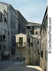 Tuscany old town detail. Group of stone made houses on...